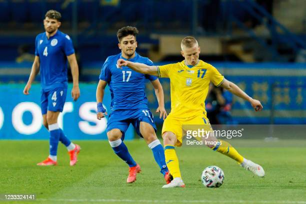 Loizos Loizou of Cyprus and Oleksandr Zinchenko of Ukraine battle for the ball during the international friendly match between Ukraine and Cyprus at...