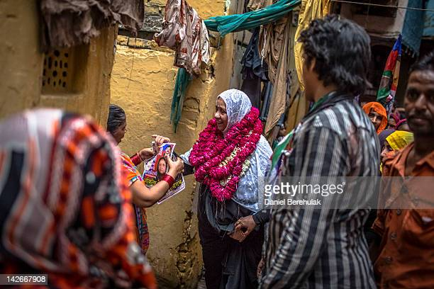 Lok Janshakti Party candidate Akila Begum hands out leaflets to supporters as she canvases on April 11 2012 in New Delhi India The Municipal...