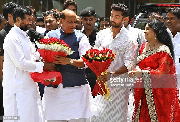 Lok Janshakti Party chief Ram Vilas Paswan along with his wife and son Chirag Paswan meet BJP president Rajnath Singh came here to congratulate him...