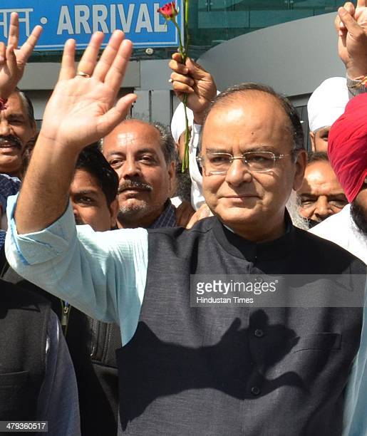 Lok Sabha candidate from Amritsar Arun Jaitley waving to his supporters upon his arrival for election campaign on March 18 2014 in Amritsar India...