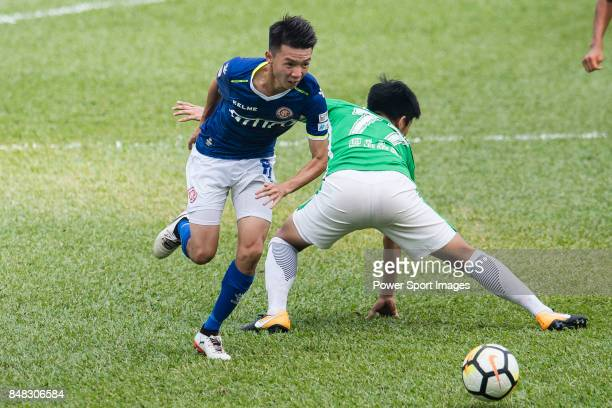 Lok Yin Lai of Rangers fights for the ball with Sing Yiu Leung of Wofoo Tai Po during the week three Premier League match between BC Rangers and...
