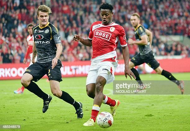 Lokeren's Alexander Scholz and Standard's Michy Batshuayi vie for the ball during the Belgian Jupiler Pro League football match between Standard de...