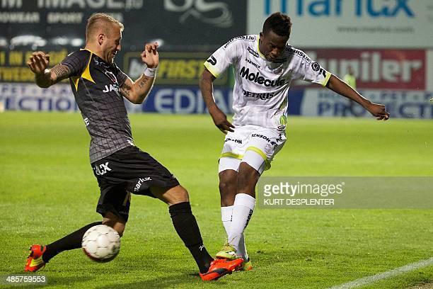 Lokeren's Jordan Remacle vies for the ball with Essevee's Bryan Verboom during the Belgian Jupiler Pro League match between Sporting Lokeren and SV...