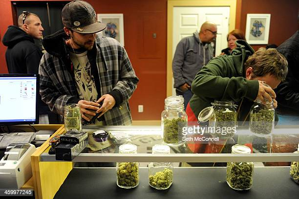 Loki watches a friend who declined to be identified smell a particularly pungent strain of marijuana called Lambs Breath at Denver Kush Club in...