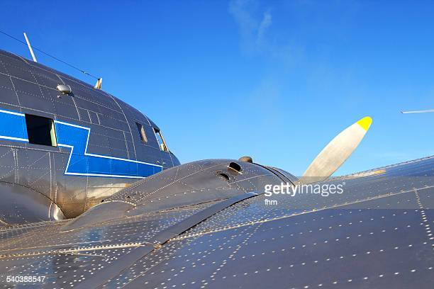 Lokking skywards at a historic airplane