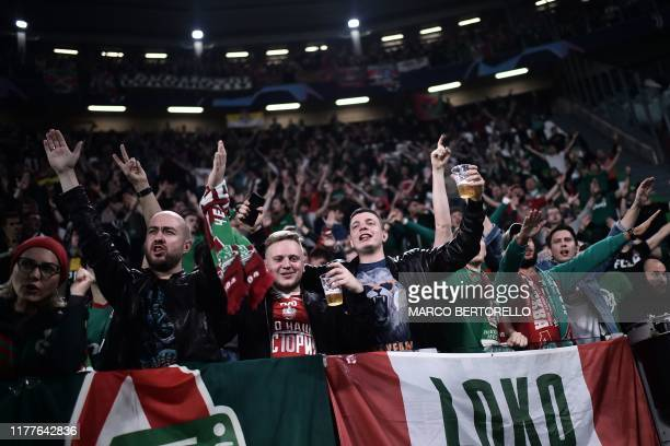 Lokomotiv fans cheer and drink beer prior to the UEFA Champions League Group D football match Juventus vs Lokomotiv Moscow on October 22 2019 at the...