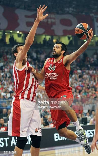 Lokomotiv Krasnodar's Krunoslav Simon vies with Crvena Zvezda's Boban Marjanovic during an Euroleague group D basketball match at the Kombank Arena...