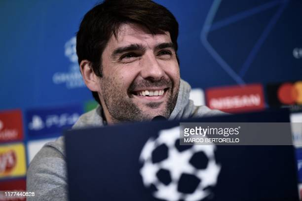Lokomotiv Moscow's Croatian defender Vedran Corluka smiles during a press conference on October 21 2019 in Turin on the eve of Lokomotiv Moscow's...