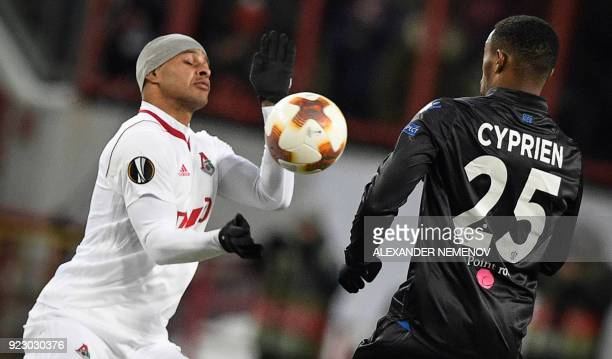 Lokomotiv Moscow's forward from Brazil Ari fights for the ball with Nice's midfielder from France Wylan Cyprien during the round of 32 second leg...