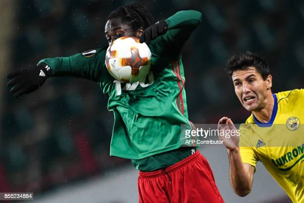 Lokomotiv Moscow's forward from Portugal Eder and FC Fastav Zlín's defender from Serbia Zoran Gajic vie for the ball during the UEFA Europa League...