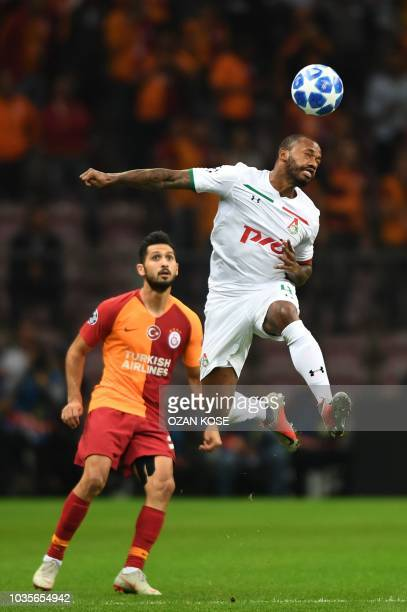 Lokomotiv Moscow's Manuel Fernandes heads the ball in front of Galatasaray's Emre Akbaba during the UEFA champions league group D football match...