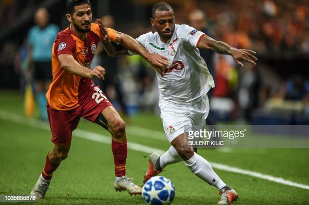 Lokomotiv Moscow's Manuel Fernandez vies with Galatasaray's Emre Akbaba during the UEFA champions league group D football match between Galatasaray...
