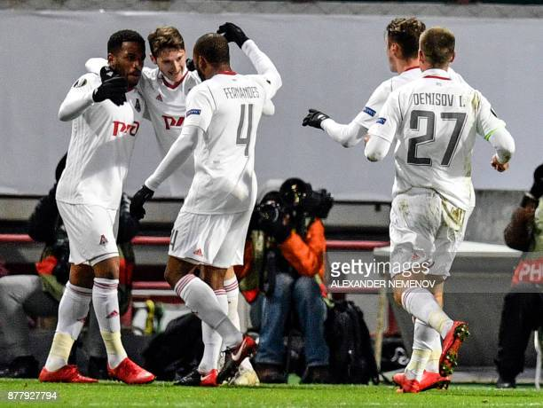 Lokomotiv Moscow's players celebrate a goal during the UEFA Europe League Group F football match between Lokomotiv Moscow and FC Kobenhavn at the...