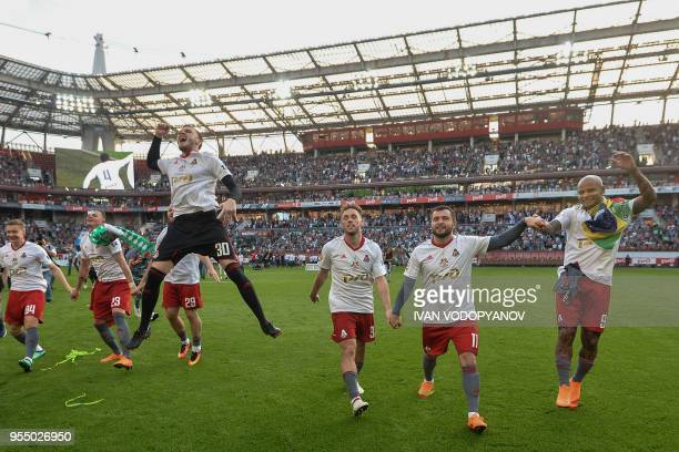 Lokomotiv Moscow's players celebrate at the end of the match against Zenit St Petersburg as they claimed their third ever Russian league title at...