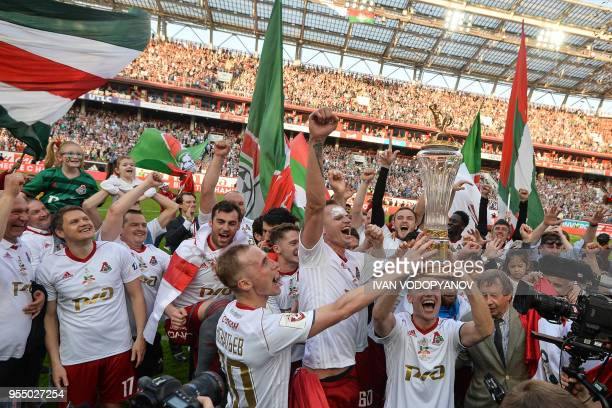 Lokomotiv Moscow's players celebrate with the trophy as they claimed their third ever Russian league title following the match against Zenit St...