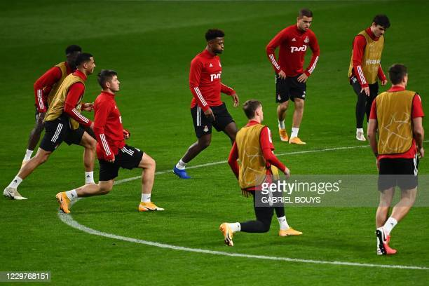 Lokomotiv Moscow's players take part in a training session at the Wanda Metropolitano Stadium in Madrid on November 24 2020 on the eve of the UEFA...