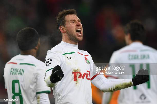 Lokomotiv Moscow's Polish midfielder Grzegorz Krychowiak celebrates after scoring a goal during the UEFA Champions League group D football match...