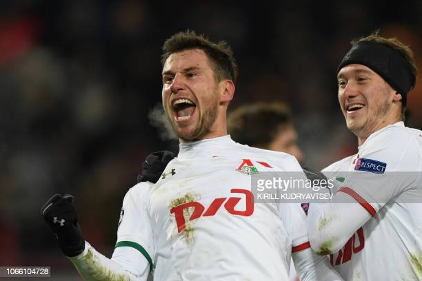 Lokomotiv Moscow's Polish midfielder Grzegorz Krychowiak celebrates with teammates after scoring a goal during the UEFA Champions League group D...