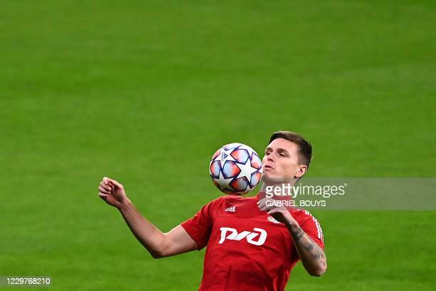 Lokomotiv Moscow's Russian defender Vitaly Lystsov controls a ball during a training session at the Wanda Metropolitano Stadium in Madrid on November...