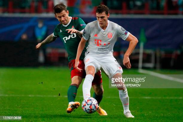 Lokomotiv Moscow's Russian forward Fedor Smolov and Bayern Munich's French defender Benjamin Pavard vie for the ball during the UEFA Champions League...