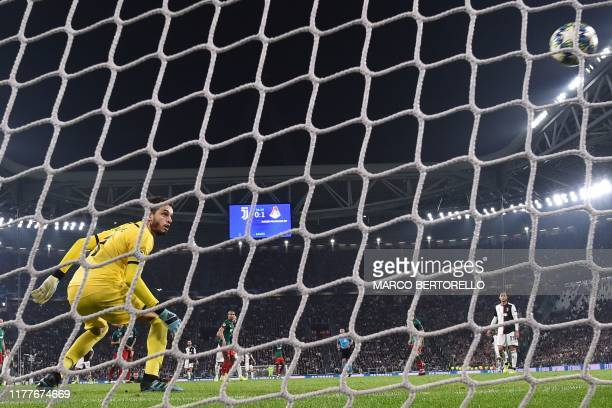 Lokomotiv Moscow's Russian goalkeeper Guilherme watches the ball enter the cage as Juventus' Argentine forward Paulo Dybala scores an equalizer...