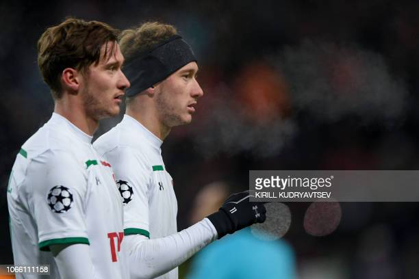 Lokomotiv Moscow's Russian midfielder Aleksei Miranchuk and Lokomotiv Moscow's Russian midfielder Anton Miranchuk during the UEFA Champions League...