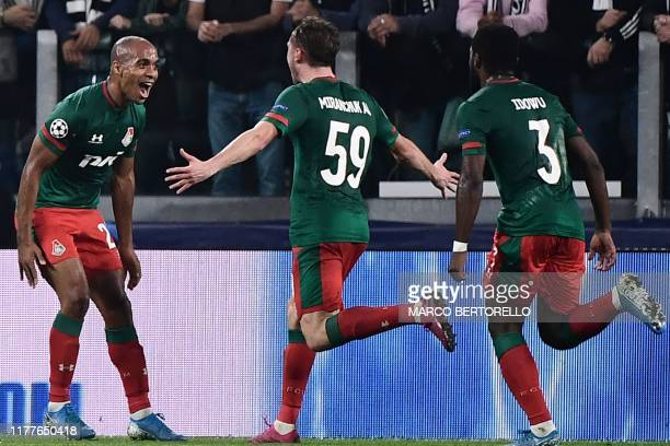 Lokomotiv Moscow's Russian midfielder Aleksey Miranchuk celebrates with Lokomotiv Moscow's Portuguese midfielder Joao Mario after opening the scoring...
