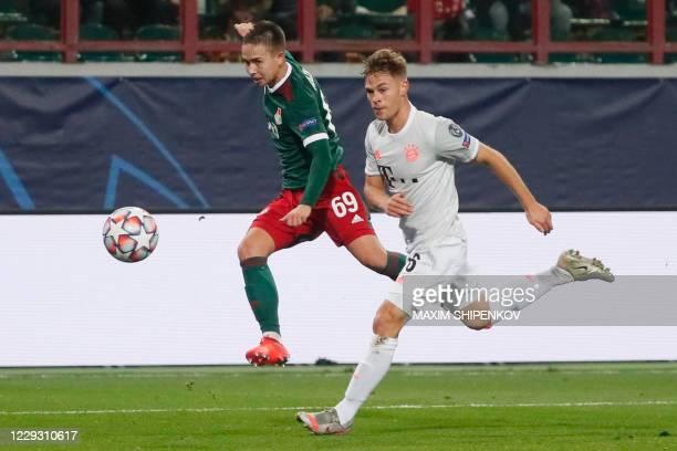 Lokomotiv Moscow's Russian midfielder Daniel Kulikov and Bayern Munich's German midfielder Joshua Kimmich vie for the ball during the UEFA Champions...