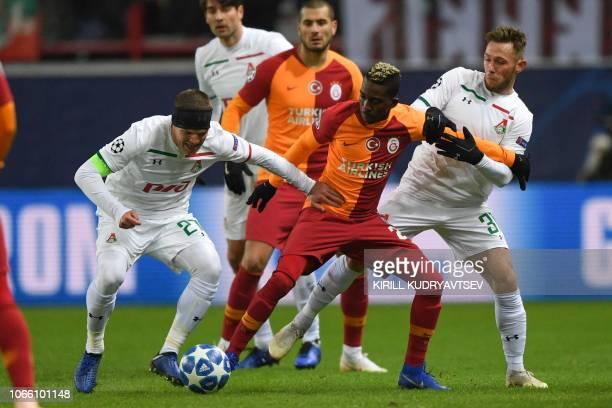 Lokomotiv Moscow's Russian midfielder Igor Denisov Galatasaray's Nigerian forward Henry Onyekuru and Lokomotiv Moscow's Polish midfielder Maciej...