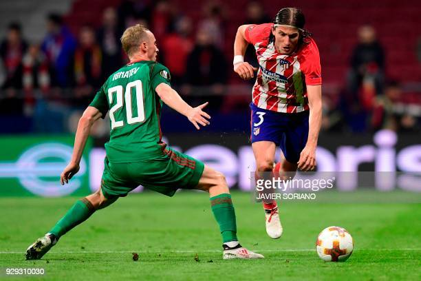 Lokomotiv Moscow's Russian midfielder Vladislav Ignatyev vies with Atletico Madrid's Brazilian defender Filipe Luis during the Europa League Round of...