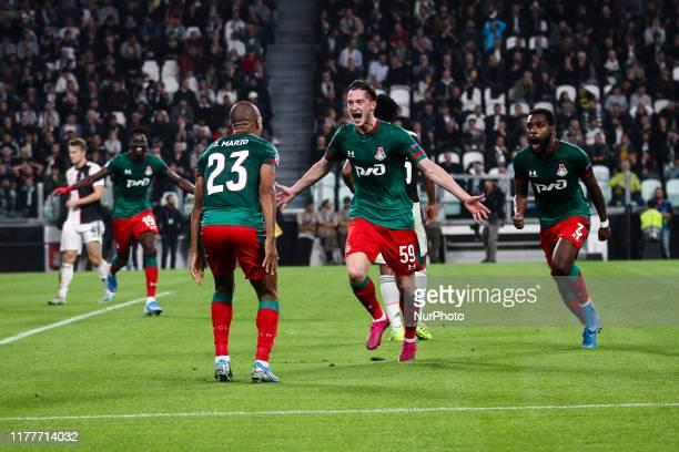 Lokomotiv Moskva midfielder Aleksej Mirancuk celebrates after scoring his goal to make it 01 during the Uefa Champions League group stage football...