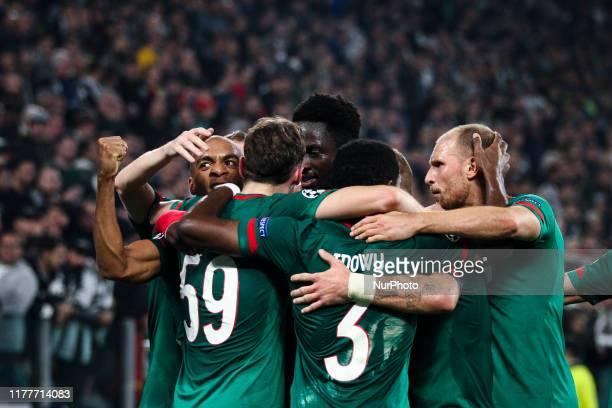 Lokomotiv Moskva midfielder Aleksej Mirancuk celebrates with his teammates after scoring his goal to make it 01 during the Uefa Champions League...