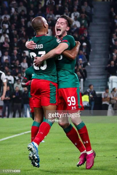 Lokomotiv Moskva midfielder Aleksej Mirancuk celebrates with Lokomotiv Moskva midfielder Joao Mario and Lokomotiv Moskva defender Brian Idowu after...