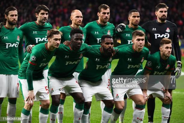 Lokomotiv players line up before the UEFA Champions League football match between Club Atletico de Madrid and Lokomotiv Moscow at the Wanda...