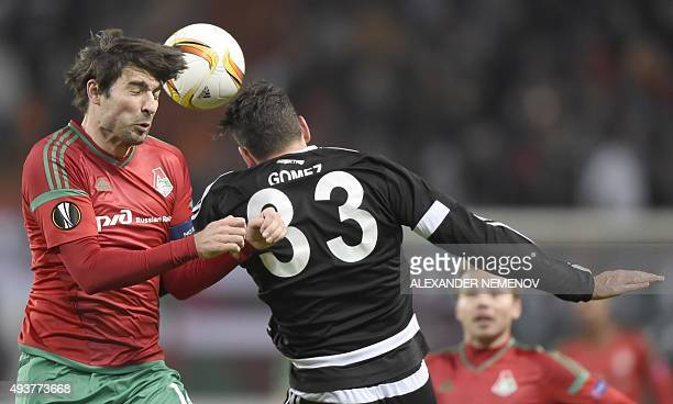 Lokomotiv's defender Vedran Corluka vies for the ball with Besiktas' forward Mario Gomez during the UEFA Europa League group H football match between...