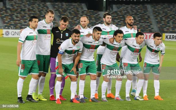 FC Lokomotiv's players pose for a photograph prior to the AFC Champions League football match between AlWahda and FC Lokomotiv at the Sheikh Zayed...