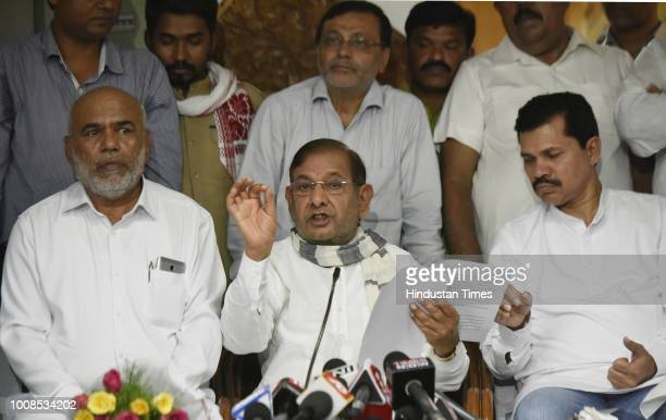 Loktantrik Janata Dal party Sharad Yadav speaks as Bahujan Mukti Party chief B L Matang looks on during a joint press conference after the...