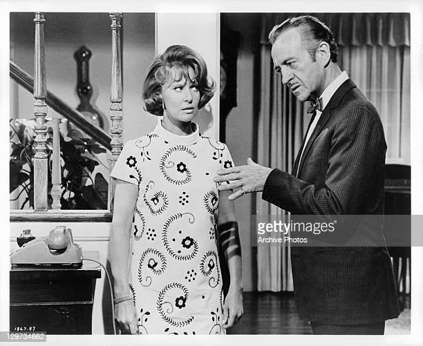 Lola Albright listens to David Niven in a scene from the film 'The Impossible Years' 1968