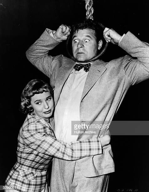 Lola Albright tries to prevent Jack Carson from hanging himself in the film 'The Good Humor Man' directed by Lloyd Bacon for Columbia