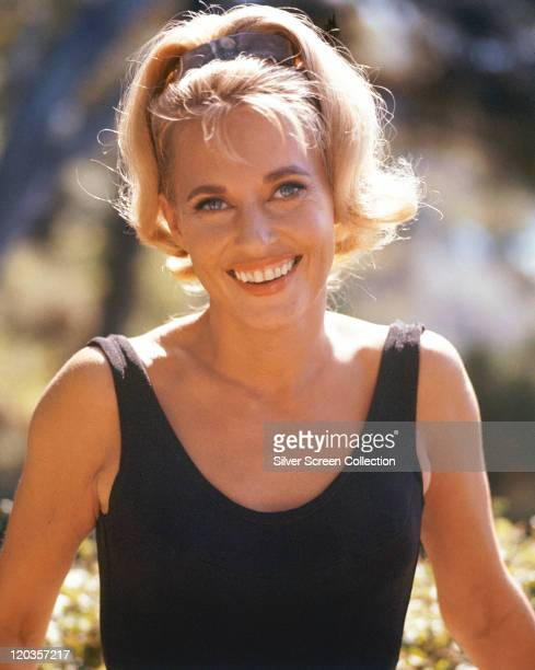 Lola Albright US actress smiling wearing a black vest top circa 1965