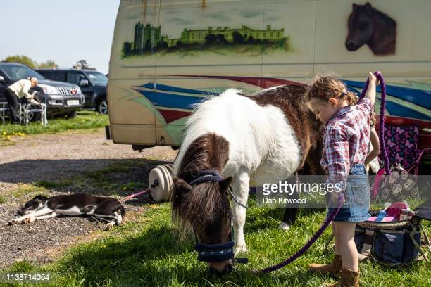 Lola holds horse Lula during the annual 'London Harness Horse Parade' on Easter Monday at The South of England Event Centre on April 22 2019 in...