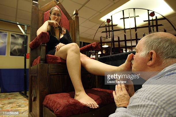 Lola is given a ''foot massage'' during the 8th annual DomCon LA convention on May 20 2011 in Los Angeles California The erotic domination convention...