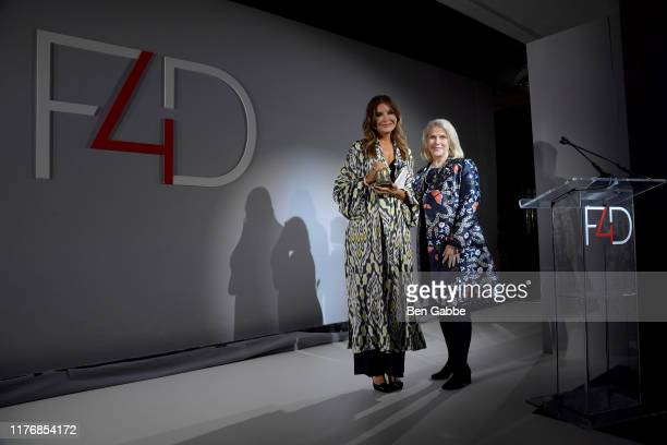 Lola KarimovaTillyaeva and Francine Lefrak pose onstage during Fashion 4 Development's 9th Annual Official First Ladies Luncheon at The Pierre Hotel...