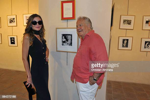 Lola KarimovaTillyaeva and Massimo Gargia attend the Exhibition Launch Private Photo Collection Of Massimo Gargia on July 28 2016 in SaintTropez...