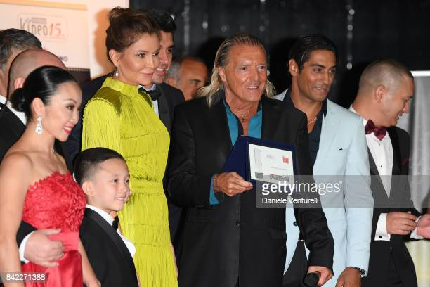 Lola KarimovaTillyaeva Armand Assante and guests pose with the award at the Kineo Diamanti Awards during the 74th Venice Film Festival at Excelsior...