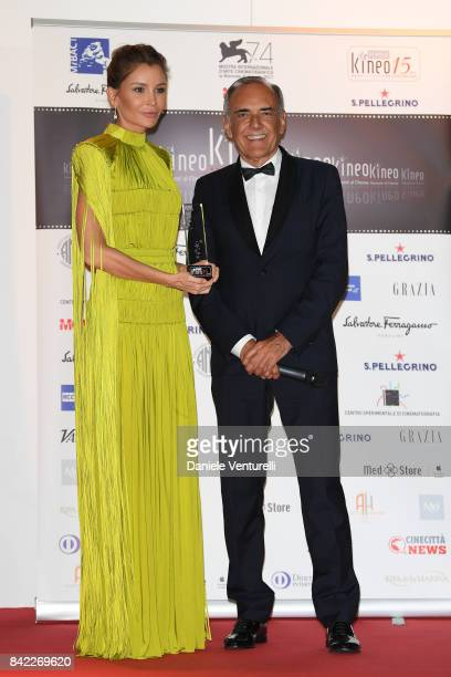 Lola KarimovaTillyaeva is awarded by Alberto Barbera at the Kineo Diamanti Awards during the 74th Venice Film Festival at Excelsior Hotel on...