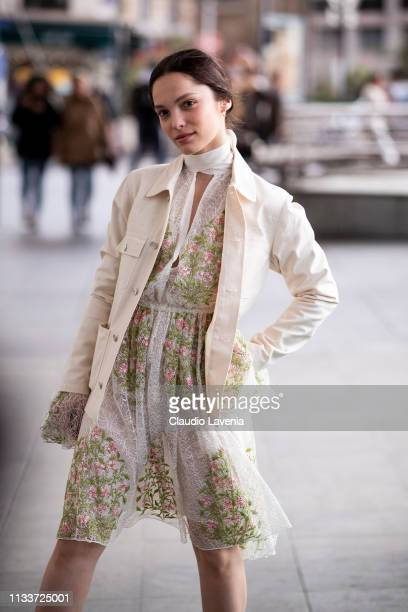 Lola Le Lann, wearing a floral mini dress and cream jacket, is seen outside Giambattista Valli on Day 8 Paris Fashion Week Autumn/Winter 2019/20 on...