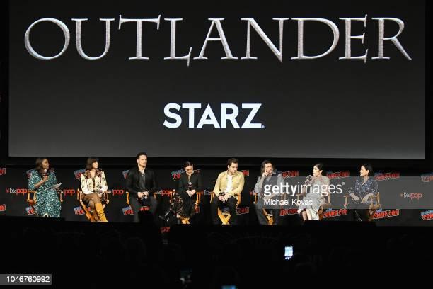 Lola Ogunnaike, Caitriona Balfe, Sam Heughan, Sophie Skelton, Richard Rankin, Ronald D. Moore, Maril Davis and Diana Gabaldon appear onstage as Starz...