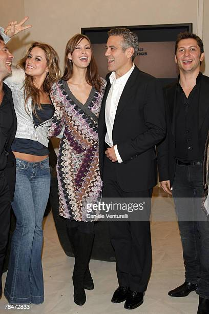 ACCESS *** Lola Ponce Sarah Larson George Clooney and Michele Malenotti attend the Belstaff new flagship store opening on December 13 2007 in Rome...