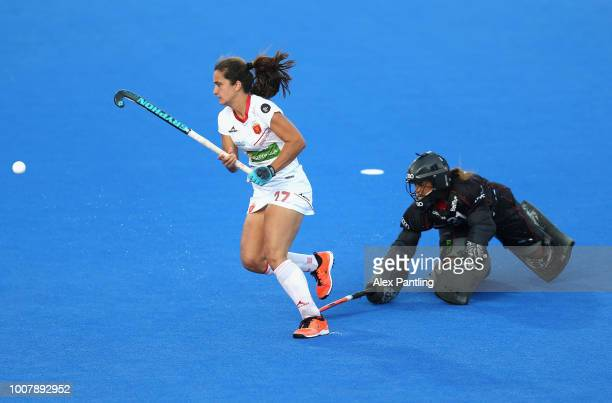 Lola Riera of Spain and Aisling D'Hooghe of Belgium in action during the penalty shoot out during the crossover game between Belgium and Spain of the...